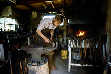 Blacksmith Hector Cole working on new gates for Highgrove the country residence of the Prince of Wales, which have been paid for by money donated by the people of Tetbury as a wedding gift for the royal couple, 1981