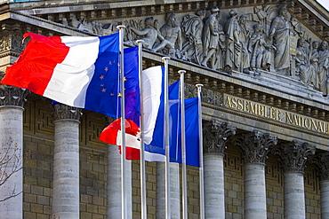 Flags fly on flagpoles outside Assembl?e Nationale, Palais Bourbon, Central Paris, France