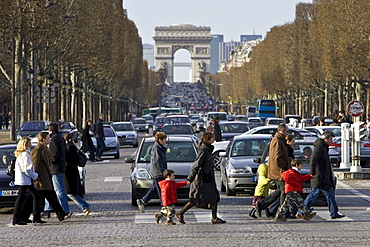 Traffic stops for pedestrians on zebra crossing across Champs-?lys?es in front of the Arc de Triomphe, Central Paris, France