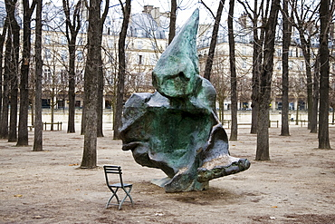 Sculpture and chair from which to observe it in Jardin des Tuileries, Paris, France