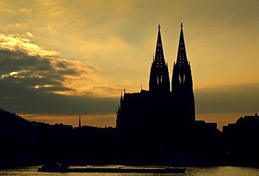 A cathedral in Cologne by the Rhine at sunset, Germany