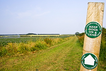 Keep Dogs On A Lead signpost by a DEFRA Conservation Walk near Holkham, Norfolk, UK