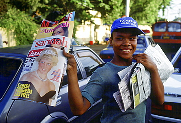 Boy sells magazines, in Jakarta, that have Diana, Princess of Wales on the cover in honour of her visit to Indonesia.
