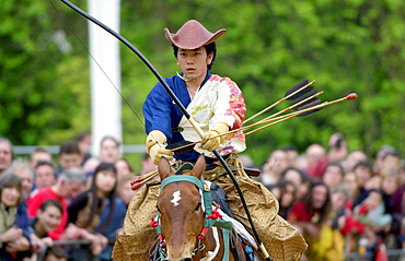 Japanese horseman displaying his skill with bow and arrows at the japanese exhibition matsuri japan in the park in hyde park, london.