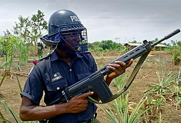 An armed policeman, Nigeria, Africa