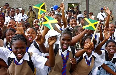 Schoolgirls waving flags and cheering
