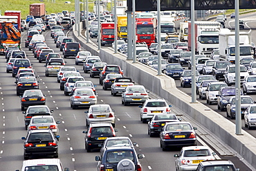 Traffic congestion of cars and lorries travelling in both directions on M25 motorway, London, United Kingdom