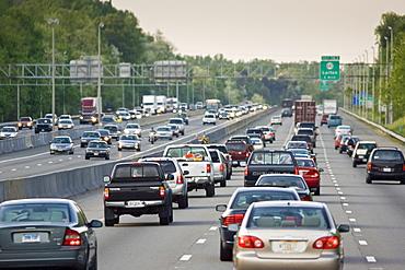 Heavy weight of traffic travelling on freeway lanes, outskirts of Washington DC, USA