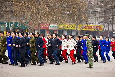 Staff on morning exercise in the grounds of the Shaanxi History Museum, Xian, China