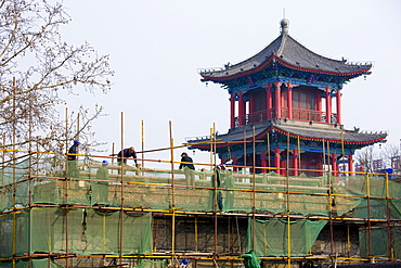 Workmen carry out repair work in Xian, China