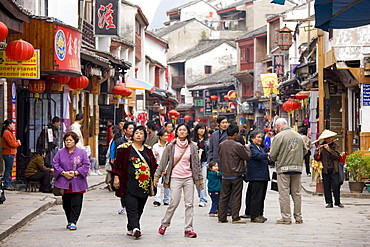 Chinese tourists in crowded shopping street in Yangshuo, China