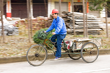 Man with delivery cart on market day near Guilin, China
