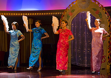 Dancers in cheongsams perform traditional show on Victoria Line Cruise Ship for Western tourists, Yangtze River, China