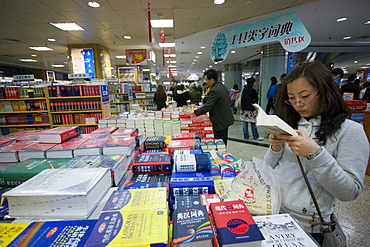Shopper in Beijing book shop, China