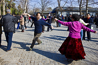 Couples dancing in park of the Temple of Heaven, Beijing, China