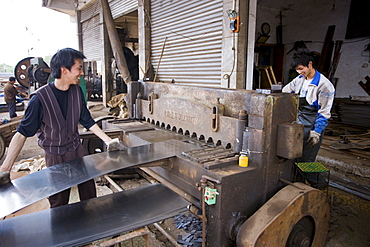 Men working at metal recycling steel in Dazu County, Chongqing, China