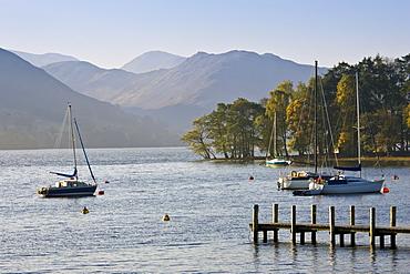 Sailing boats on Lake Ullswater, Lake District, England, United Kingdom