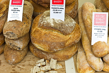 Artisan Italian bread Pagnotta, Black Olives and Stirato on sale at Exeter Street Bakery stall in Farmers' Market