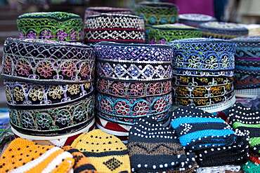 Traditional muslim prayer caps, takiyah, or kufi, on sale at Meena Bazar market in Muslim area of Old Delhi, India