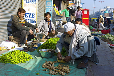 Old Delhi, Daryagang fruit and vegetable market with ginger and chillies on sale, India