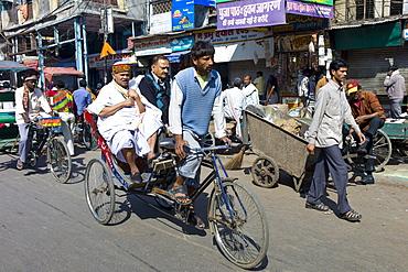 Rickshaw with passengers at Khari Baoli in Old Delhi, India