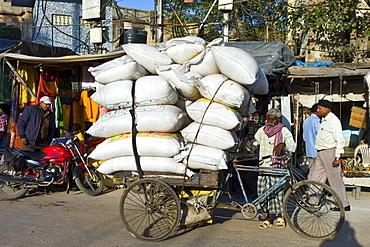 Street scene in holy city of Varanasi, Benares, Northern India