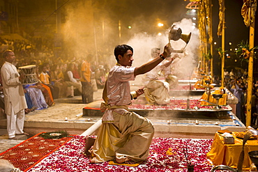 Hindu priests at sundown Aarti Ritual Ceremony of Light during Shivrati Festival in Holy City of Varanasi, Benares, India