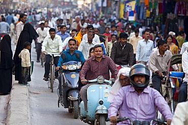Crowded street scene during holy Festival of Shivaratri in city of Varanasi, Benares, Northern India