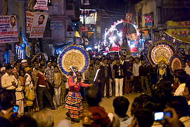Costume characters with flaming torches in crowd at Festival of Shivaratri in the holy city of Varanasi, Benares, India