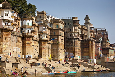 Indian Hindu pilgrims bathing in The Ganges River at Ranamahal Ghat and Chousatti Ghat in Holy City of Varanasi, India
