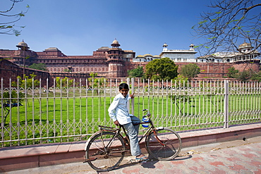 Indian boy at Agra Fort, 17th Century residence of Great Mughals and Mughal fort in Agra, Northern India