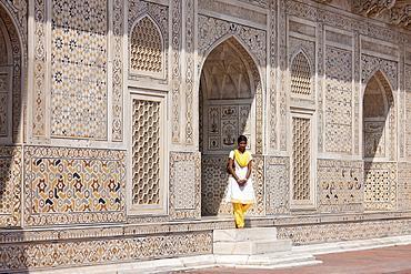 Muslim Punjabi girl at Tomb of Etimad Ud Doulah, 17th Century Mughal tomb built 1628, Agra, India
