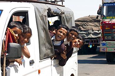 Schoolchildren on Delhi to Mumbai National Highway 8 at Jaipur, Rajasthan, Northern India
