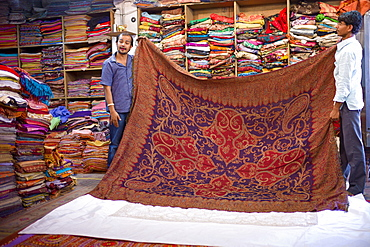 Shop selling cashmere and silk fabrics and textiles at Maharani Art Exports in Katala Bazar, Jodhpur Old Town, Rajasthan, India