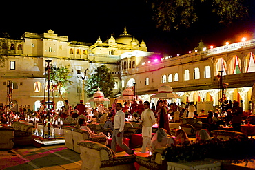 Banquet of 76th Maharana of Mewar, His Highness, Shriji Arvind Singh Mewar of Udaipur, at the City Palace to celebrate Hindu Holi Festival, Rajasthan, India. The party was in Laxmi Chowk courtyard of the Zenana Mahal (Queen's Palace)