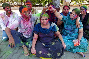 Indian people celebrating annual Hindu Holi festival of colours with powder paints in Marine Drive, Mumbai, formerly Bombay, India