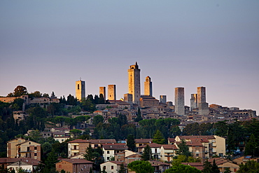 Contrast of contemporary and quaint medieval architecture of San Gimignano and its famous towers in Tuscany, Italy