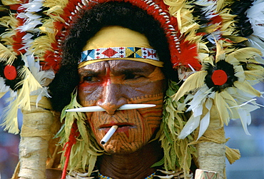 A cigarette between the lips matches the bone through his nose for this man at a Sing Sing tribal gathering in Papua New Guinea