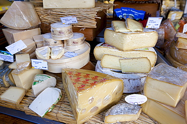 German artisan cheeses on sale at Viktualienmarkt food market in Munich, Bavaria, Germany