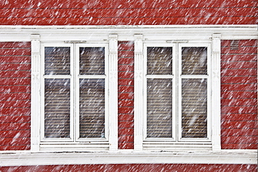 Traditional architecture on snowy day in city of Tromso, in the Arctic Circle in Northern Norway