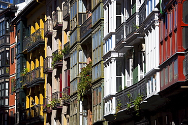 Traditional glasshouses with glass-covered balconies in Bilbao, Spain