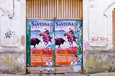 Plaza de Toros de Santona bullfight poster and anti-police abusive slogan in Cantabria, Northern Spain