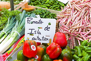 Pimentos, leeks, demi-sec beans of Cantabria on sale in food market in Santander, Northern Spain