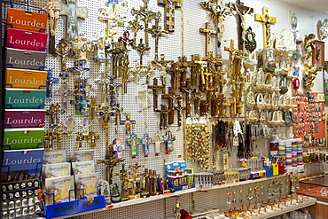 Religious icons on sale in gift shop in the pilgrimage town of Lourdes in the Pyrenees, France