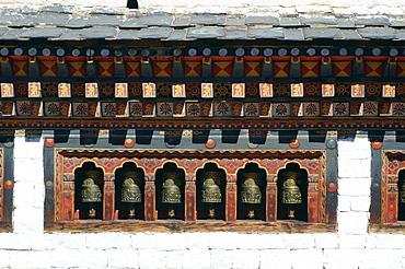Prayer wheels at Tashichho Dzong in Thimpu, Bhutan