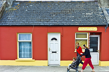 Irish women with child in stroller pushchair in street in Kilkee, County Clare, West of Ireland