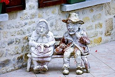 Garden ornament in paved garden in Liesville-sur-Douve, Normandy, France