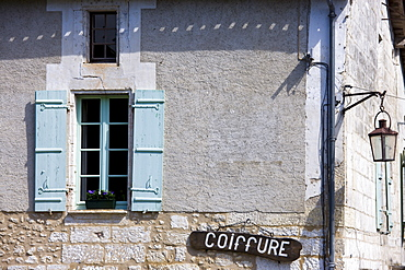 Coiffure in quaint town of Bourdeilles popular tourist destination near Brantome in Northern Dordogne, France