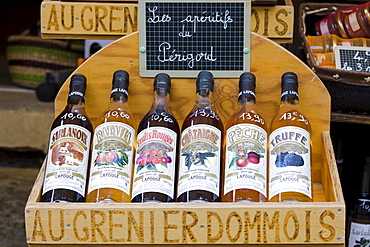 Les Aperitifs de Perigord, truffle, peach, red fruits flavor, on sale in market at Domme in the Dordogne, France