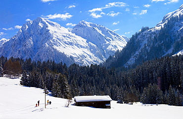 Snow covered barns in the meadows below the Alps at Klosters - Amongst the Silvretta group of the Swiss Alps. Road to Silvretta.Mountain at right is P.Linard 3411 metres high